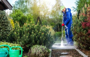 Man Power Washing Path